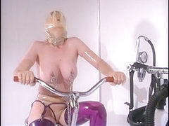Sexy blond playgirl can't live without rubber servitude